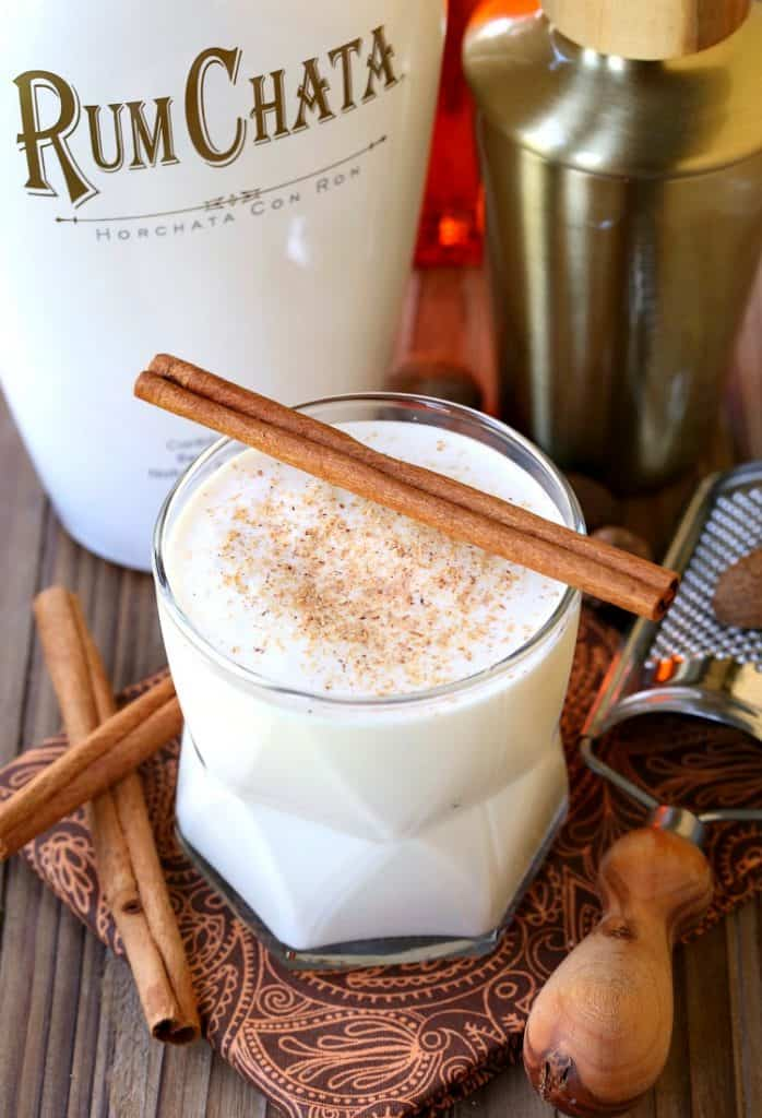 Campfire Milk Punch with a cinnamon stick on top