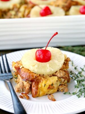 Slice pof pineapple and sausage stuffing on a plate