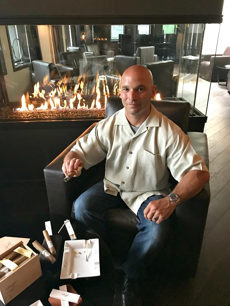 Dan by fire at cigar lounge