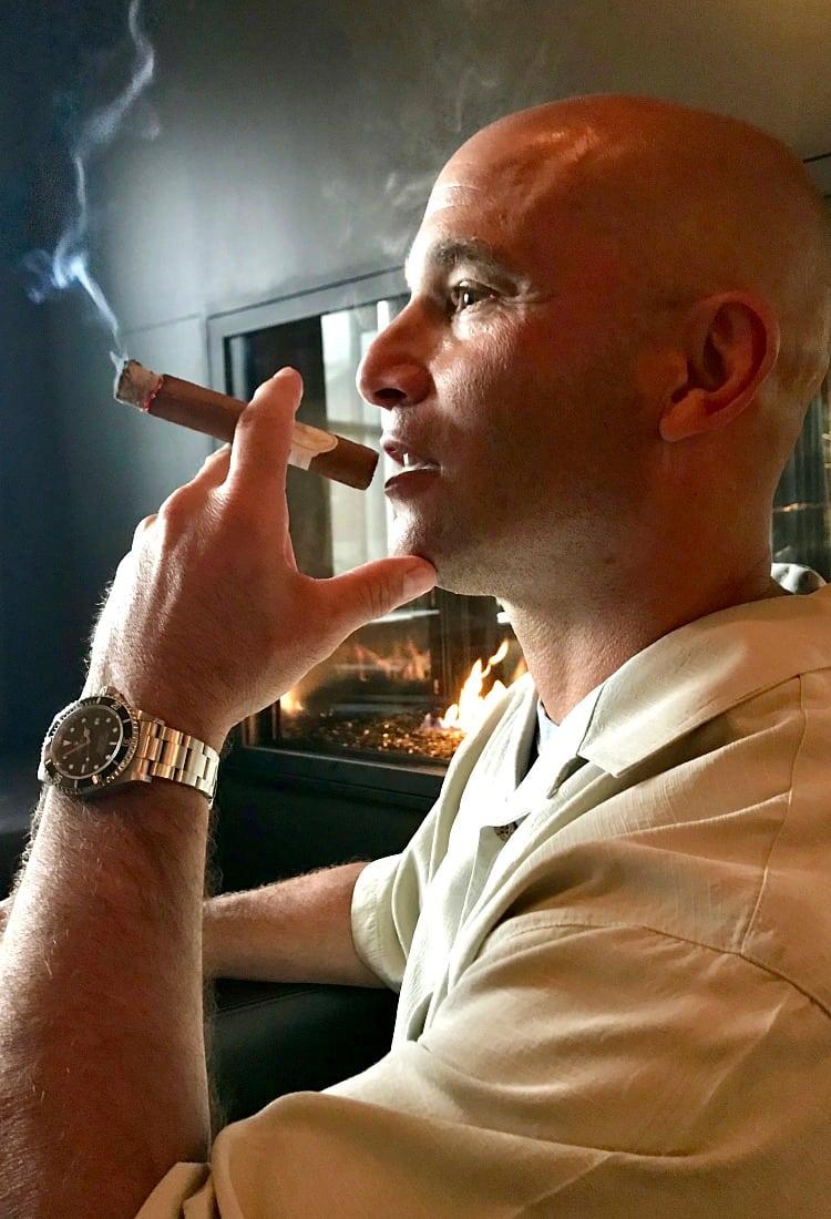 Dan smoking cigar