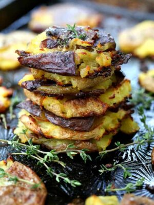 Stick of Butter Smashed Potatoes stacked on a tray