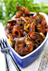 Sweet and Spicy Balsamic Glazed Shrimp with forks and parsley
