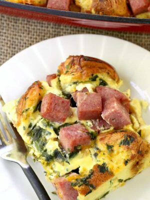 Taylor Ham Egg and Cheese Breakfast Casserole on a plate with a fork