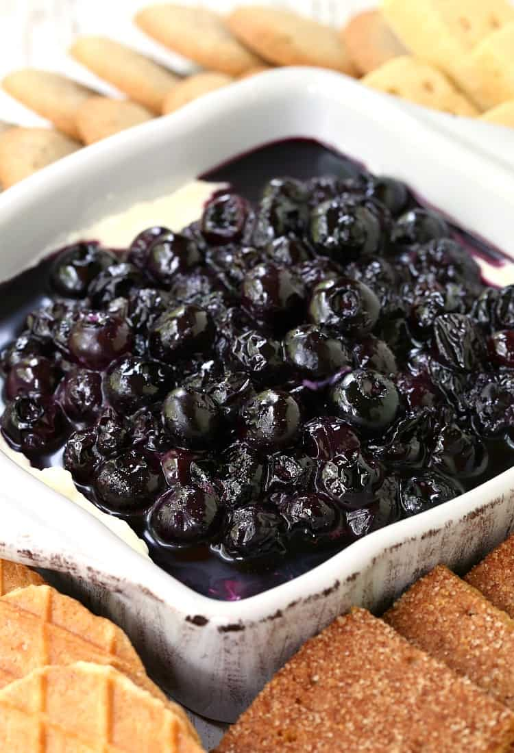 No Bake Blueberry Cheesecake Dip in a dish with cookies