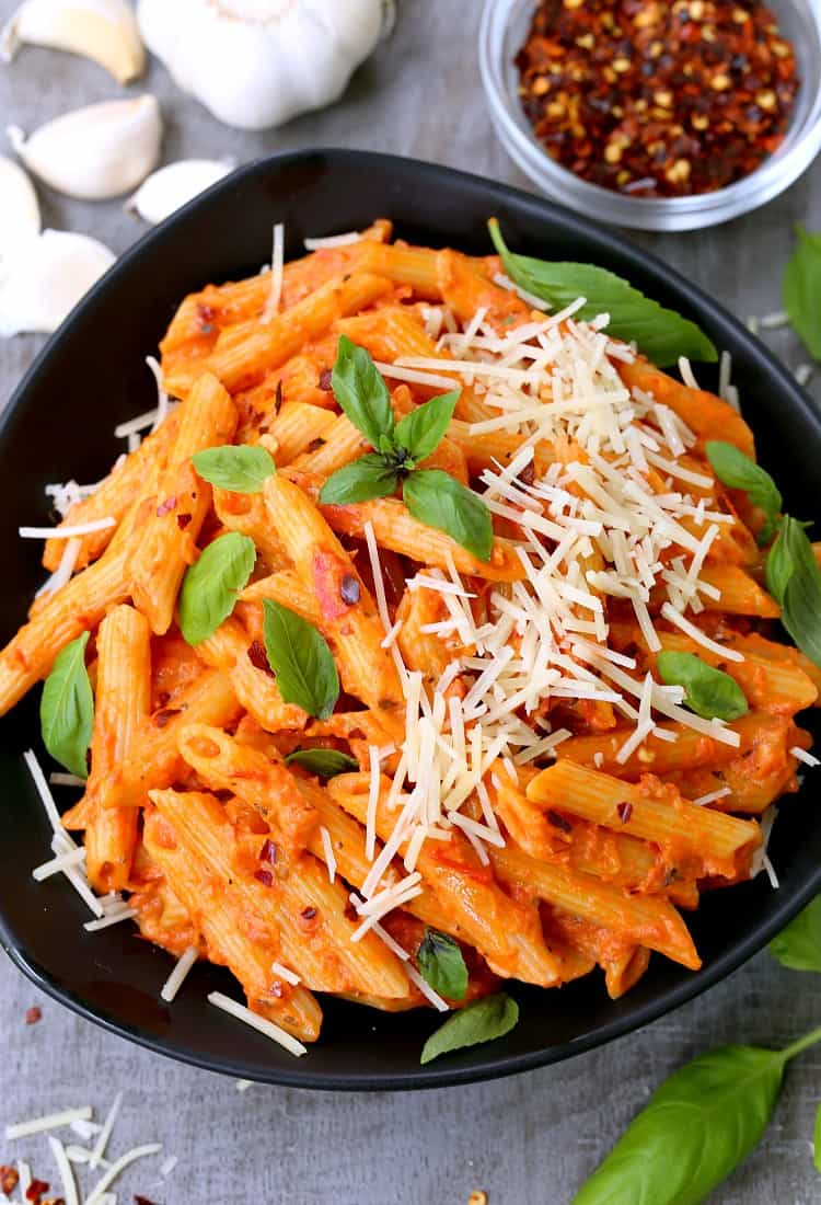 Easiest Penne Vodka Ever on a board form the top with parmesan cheese