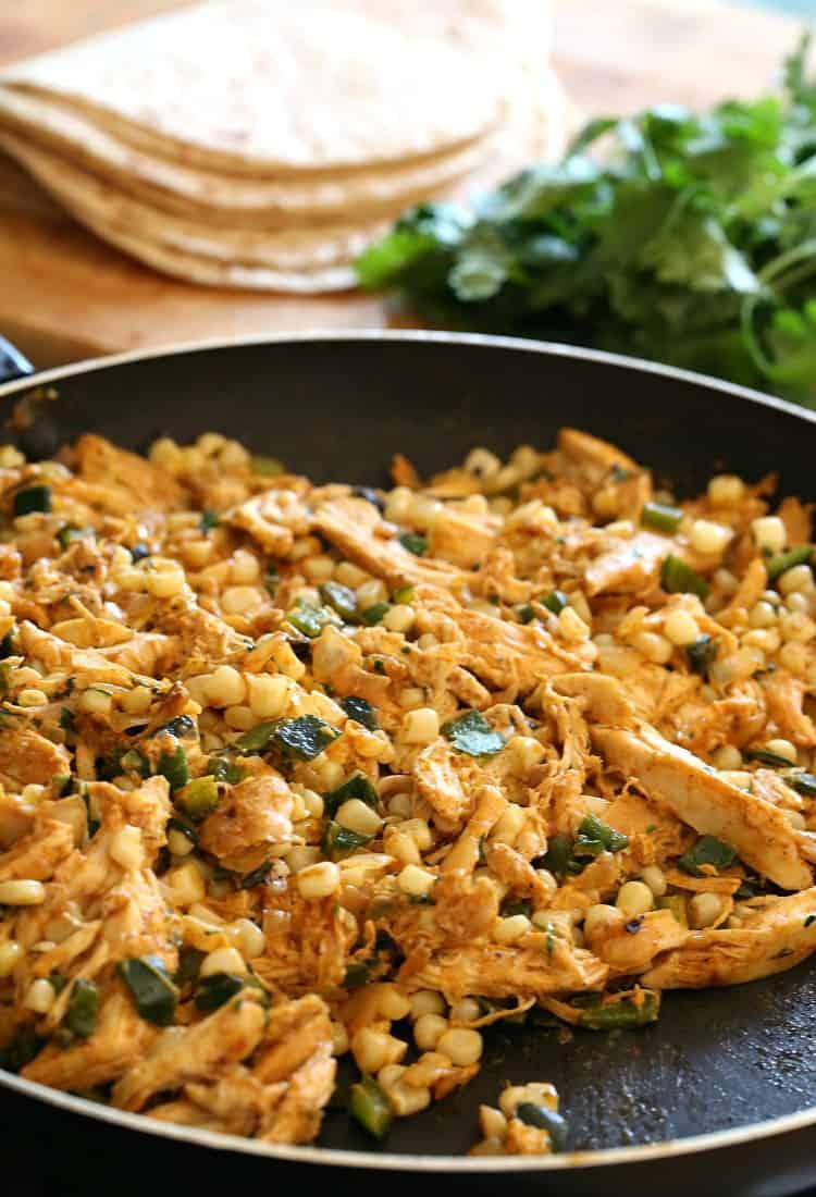 filling in skillet for chicken enchiladas