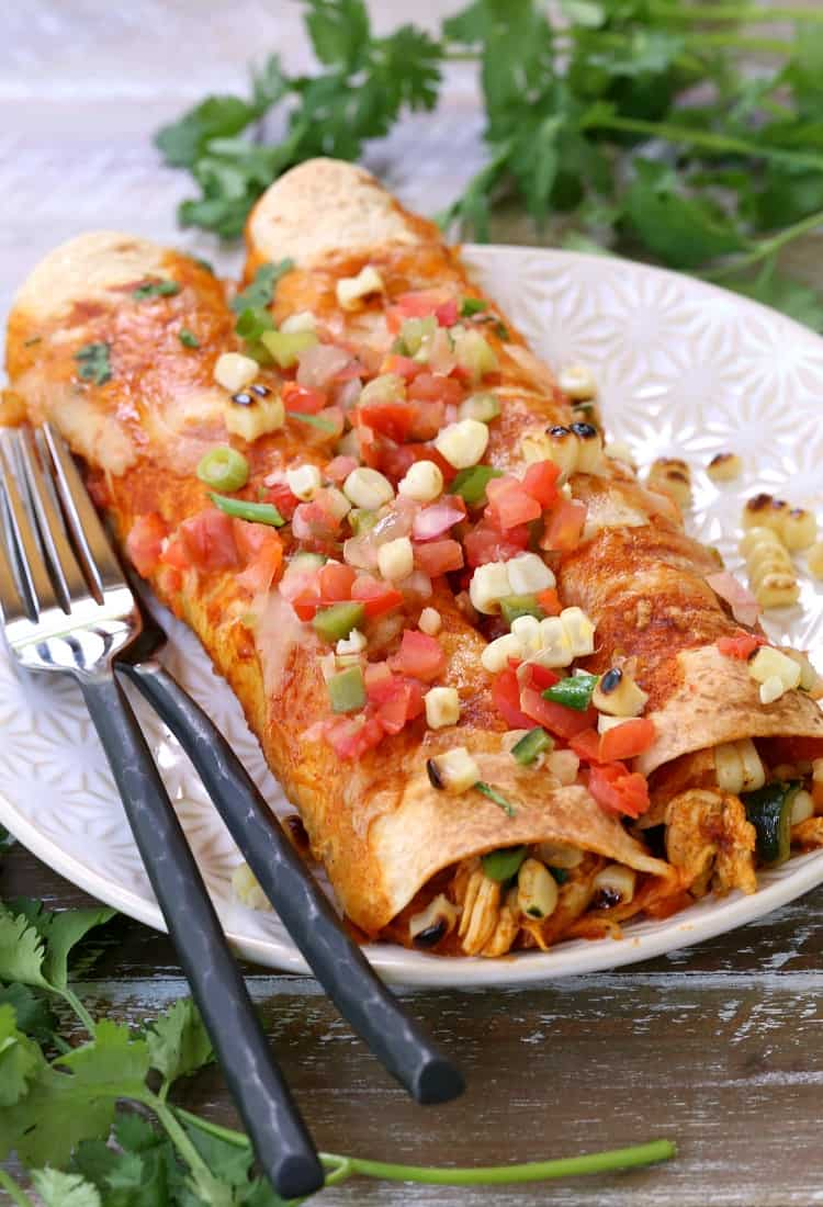 chicken enchiladas on plate with forks