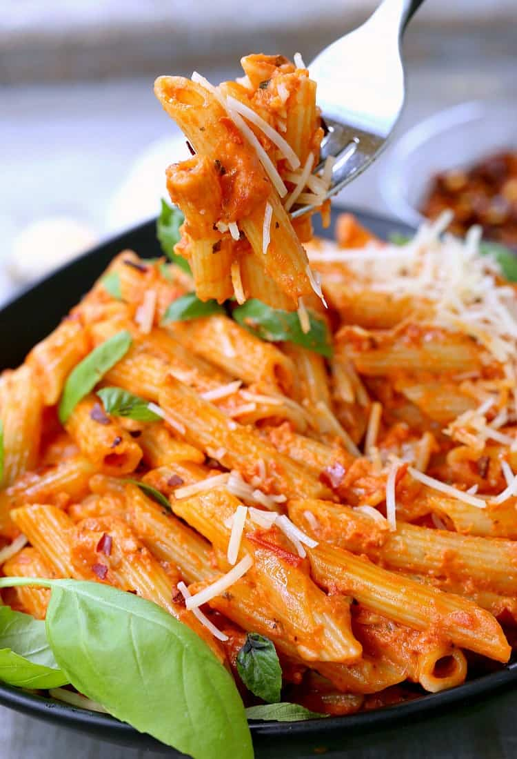 Easiest Penne Vodka Ever with a fork taking a bite