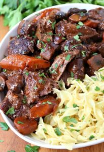 French Bistro Beef Stew in a bowl with noodles and vegetables