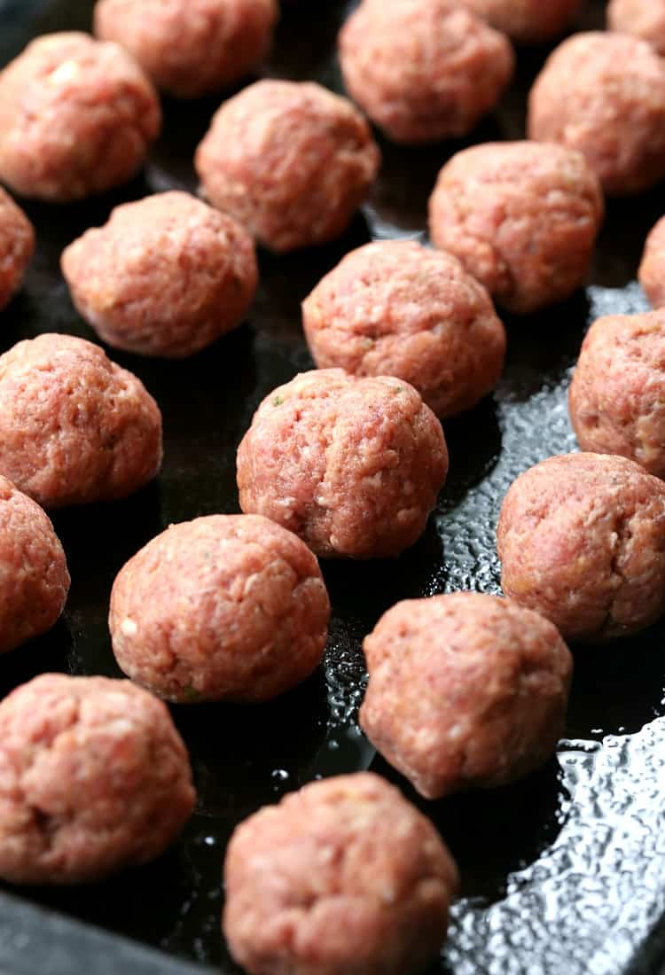 meatballs on a baking sheet for appetizer recipe