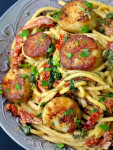 Creamy Tuscan Spaghetti with Jumbo Scallops is a scallop and spaghetti recipe in a creamy 15 minute sauce