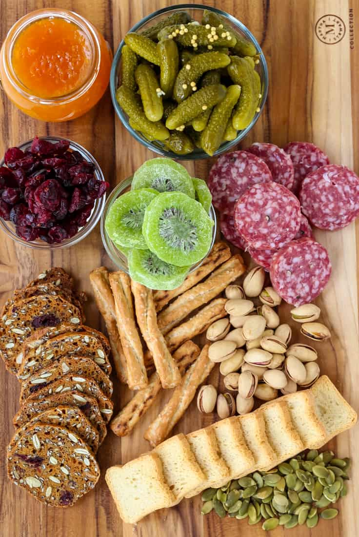 How To Make A Cheese Board using cheese, meats and a few sweet treats