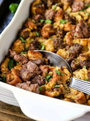 the best sausage stuffing recipe in a baking dish with a spoon