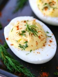 A Classic Deviled Eggs Recipe with a perfect deviled egg on a platter