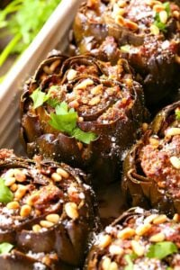 Grandma's Best Stuffed Artichokes are a side dish stuffed with sausage, cheese and pine nuts