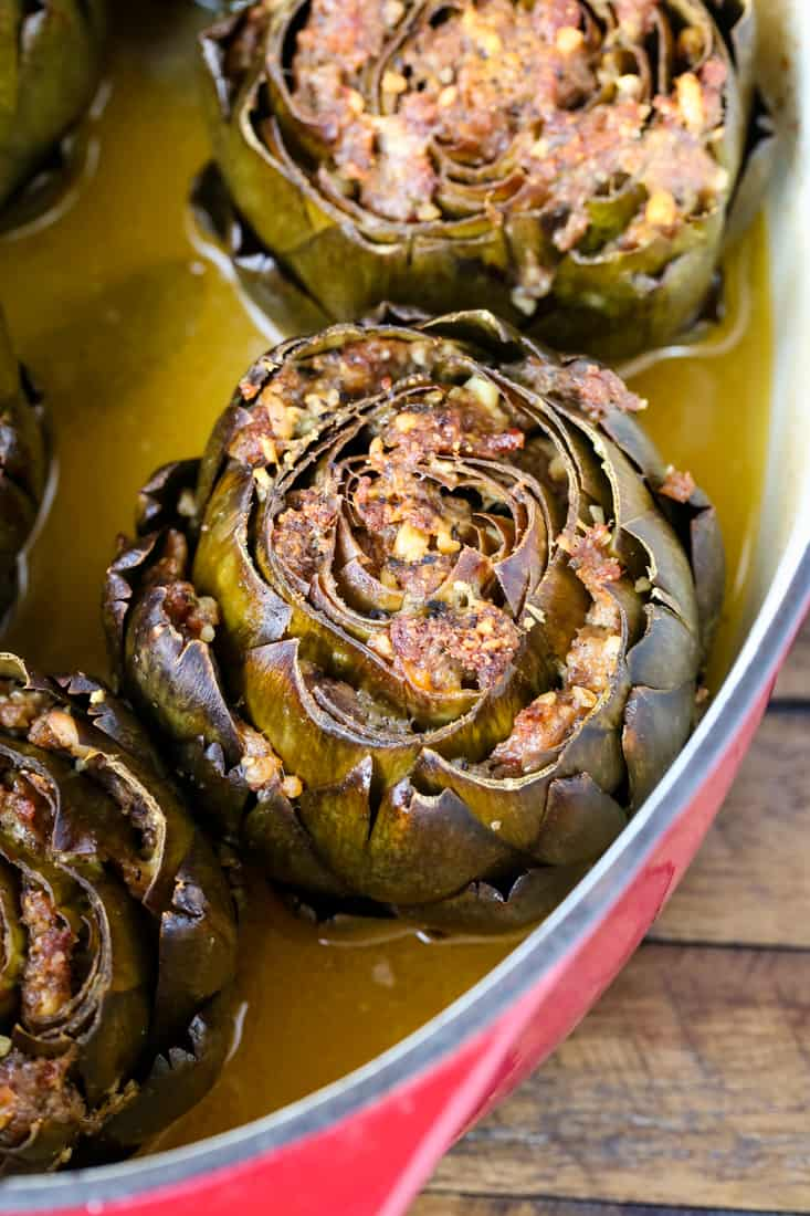 Grandma's Best Stuffed Artichokes are a side dish stuffed with sausage and cheese