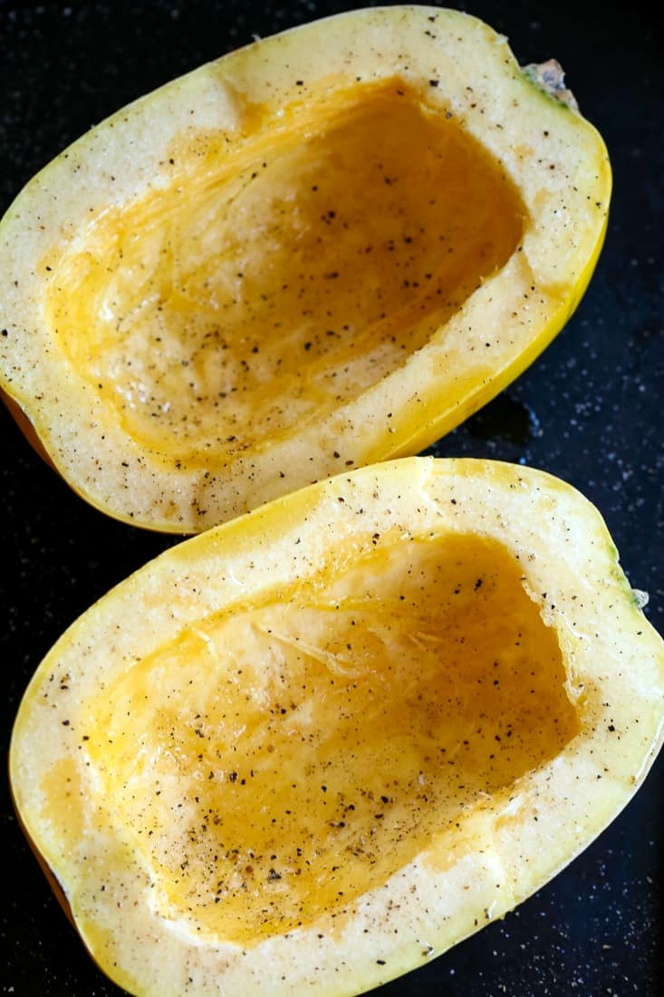 Spaghetti squash halves with salt and pepper