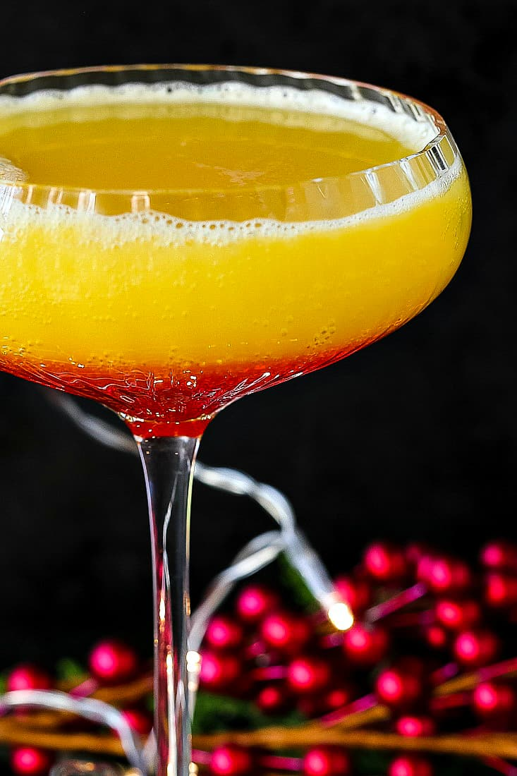 Christmas Morning Mimosa is a champagne cocktail recipe with amaretto and grenadine