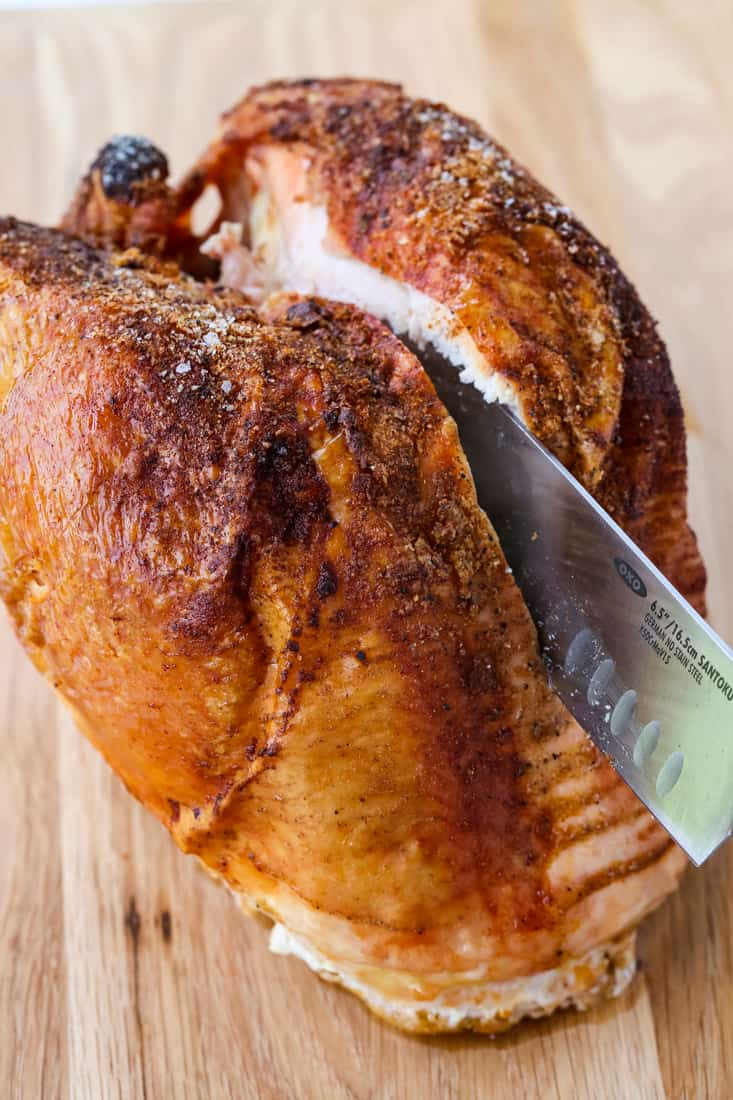 How To Cook And Carve A Turkey Breast cutting into a turkey breast