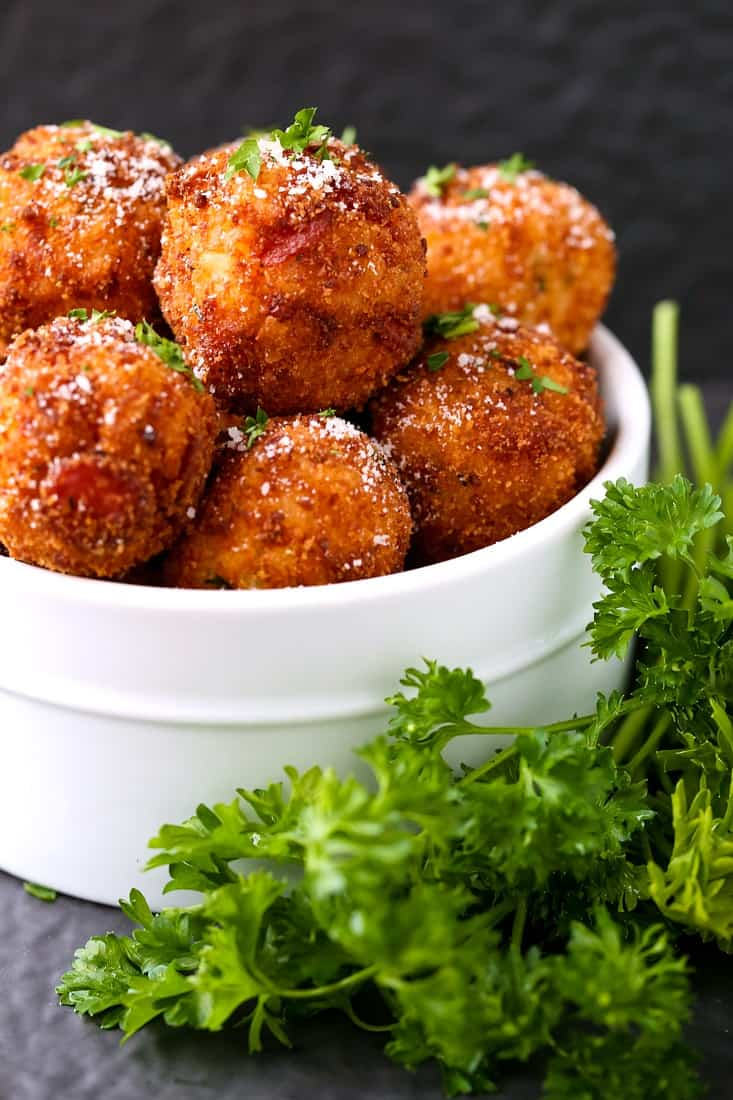 Pepperoni Pizza Arancini is an appetizer recipe that's fried with pepperoni and cheese