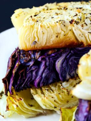 Oven Roasted Cabbage Recipe is made with purple and green cabbage