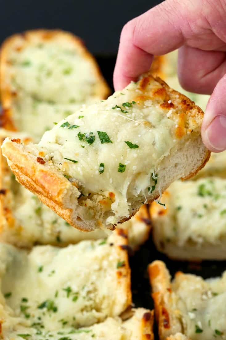 Easy Cheesy Garlic Bread is a cheese topped garlic bread made with fresh garlic and butter