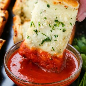 Easy Cheesy Garlic Bread is a cheese topped garlic bread that can be dipped in marinara sauce