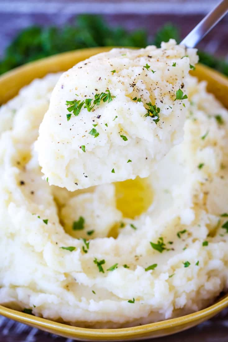 Perfectly Smooth Mashed Potatoes are riced potatoes whipped with butter and cream