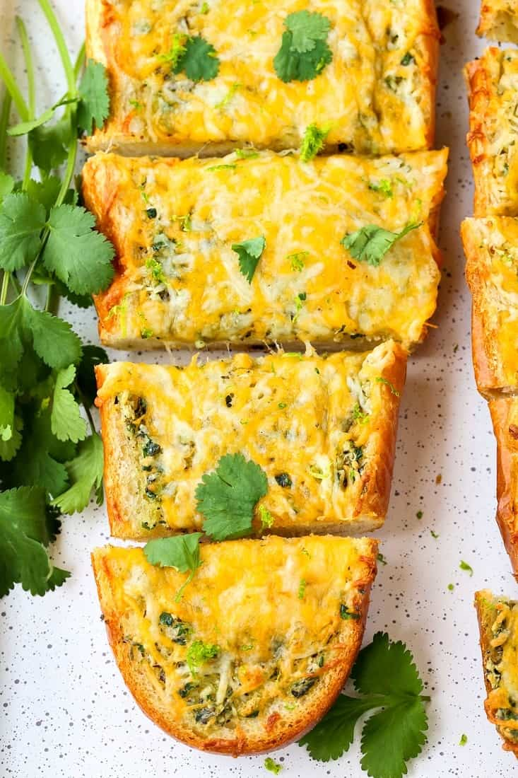 Cheesy Mexican Garlic Bread is a garlic bread recipe topped with cheese and cilantro