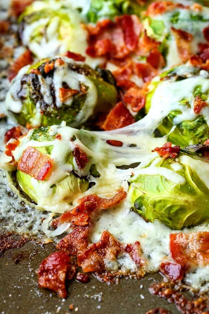 Loaded Sheet Pan Brussels Sprouts are a roasted brussels sprouts recipe with cheese and bacon
