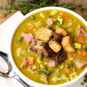 split pea soup in a white bowl with croutons