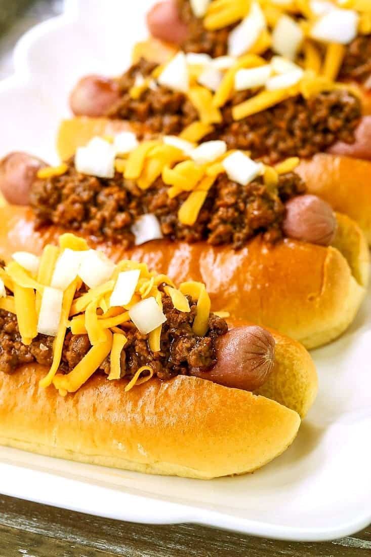 Hot Dog Chili Recipe showing hot dogs on a platter with chili and onions