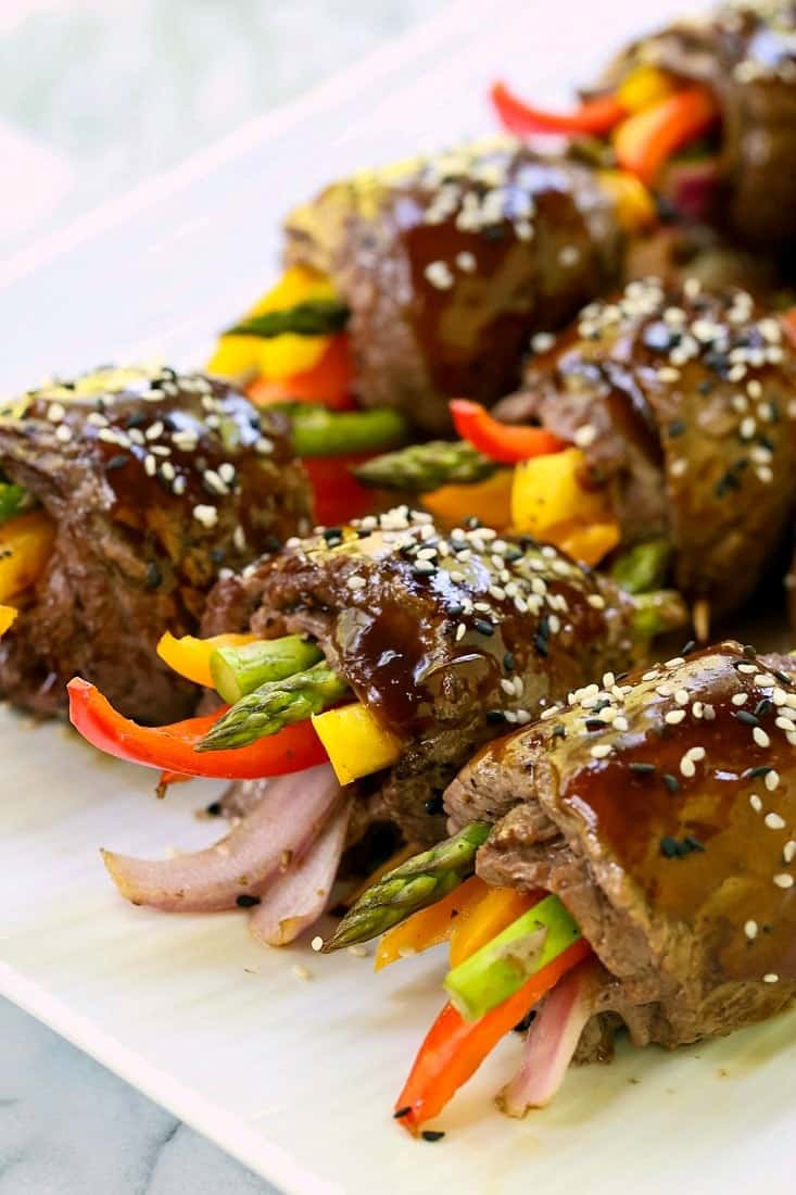 Asian Steak Roll Ups are topped with a homemade stir fry sauce