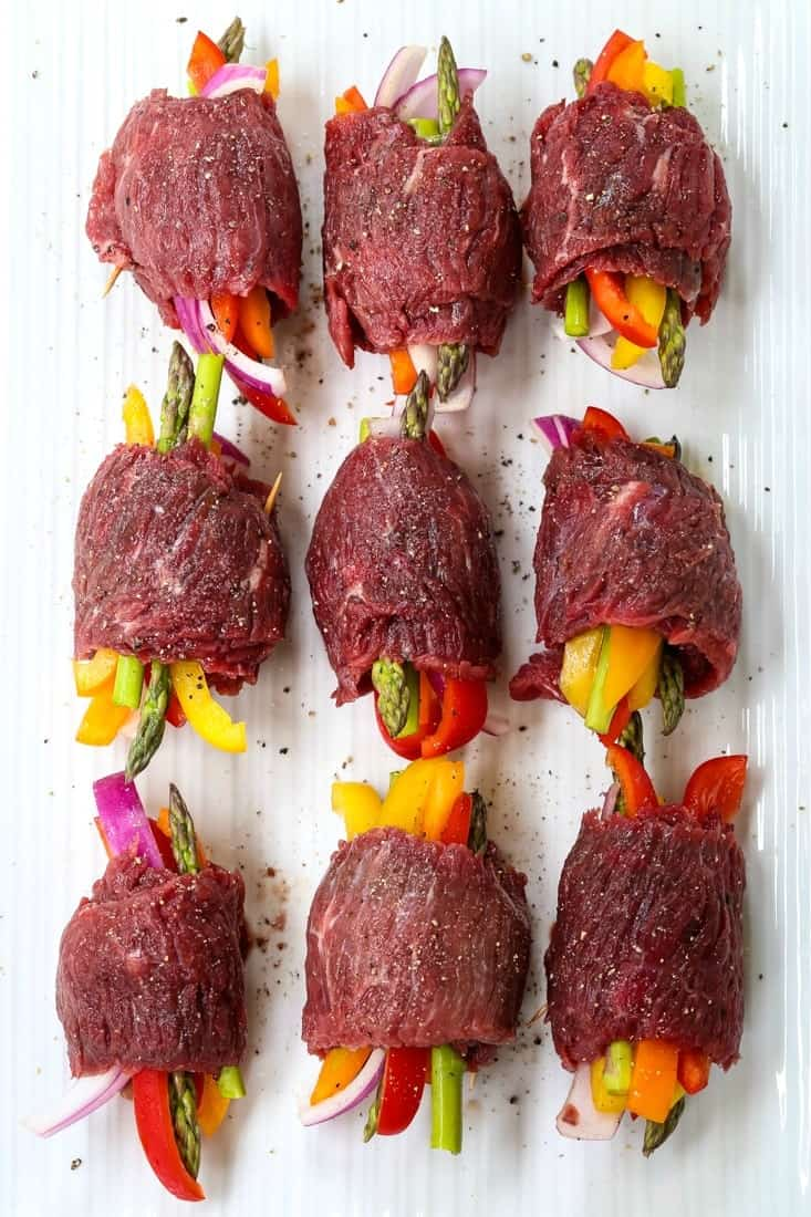 Asian Steak Roll Ups have vegetables rolled up in the center of a piece of steak