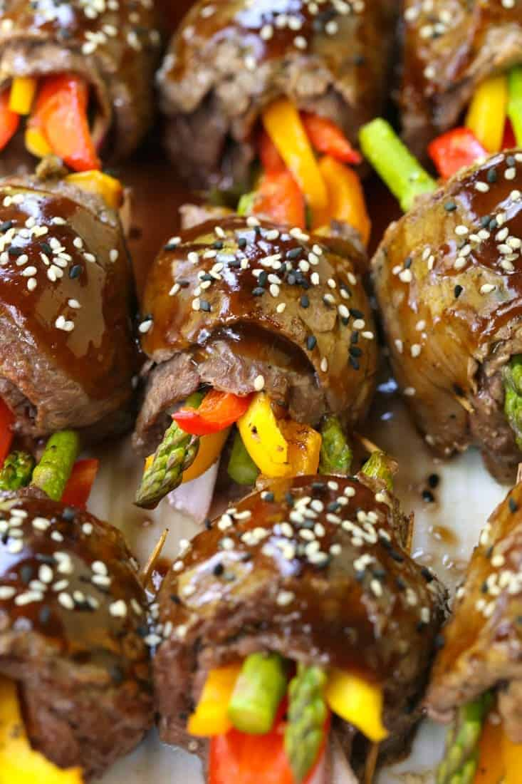 Asian Steak Roll Ups on a white platter