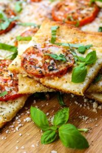 Roasted Tomato Basil Pizza is a pizza recipe with roasted tomatoes and fresh basil