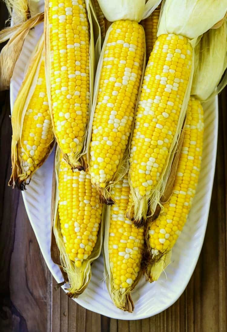 Oven Roasted Corn on the Cob shows roasted corn peeled on a platter