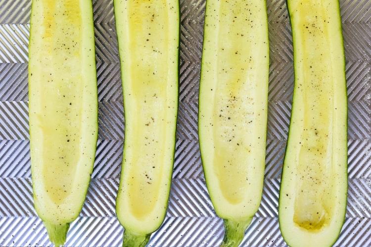 fresh zucchini hollowed out for zucchini boat recipe