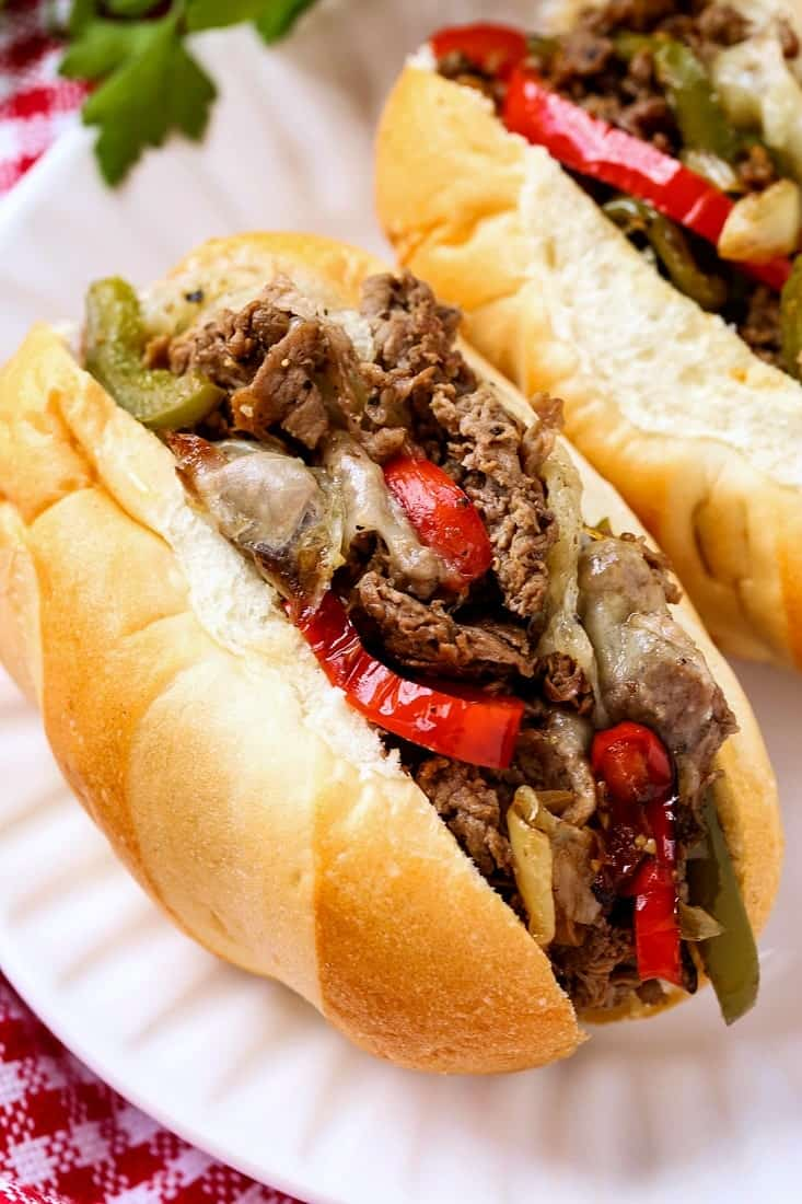 Quick Philly Cheesesteak Recipe in a sub roll on a white plate