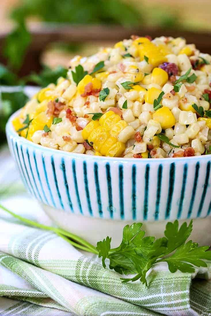 creamed corn in a bowl with parsley