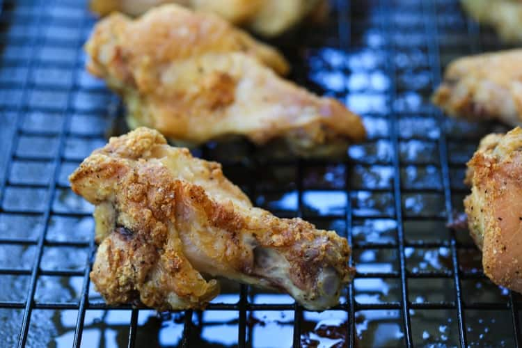 crispy chicken wings on a baking rack after cooking
