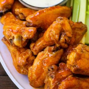 buffalo chicken wings stacked on a platter
