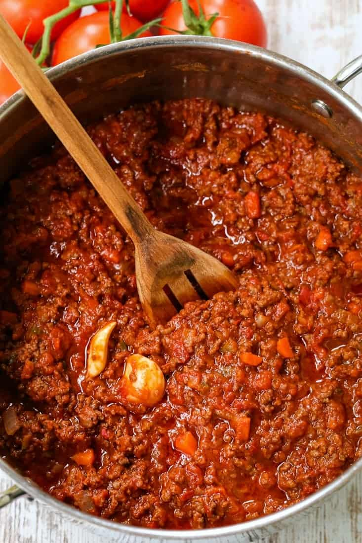 bolognese sauce in a pot with a wooden spoon