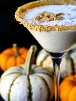 rumchata pumpkin cheesecake martini with graham crackers on top