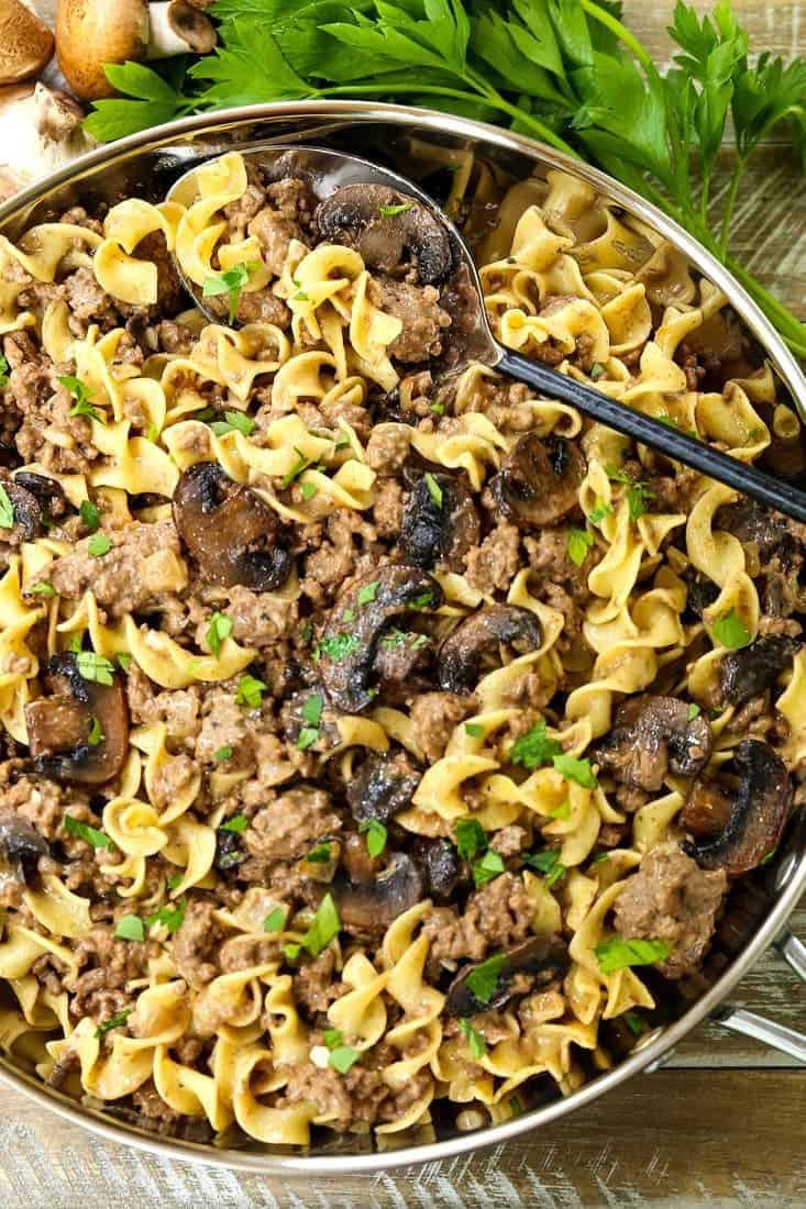 beef stroganoff mixed with noodles in a skillet