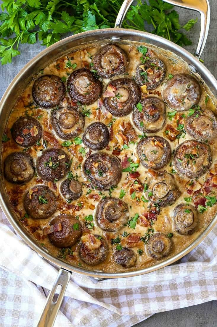 Creamy bacon mushrooms in a skillet with parsley