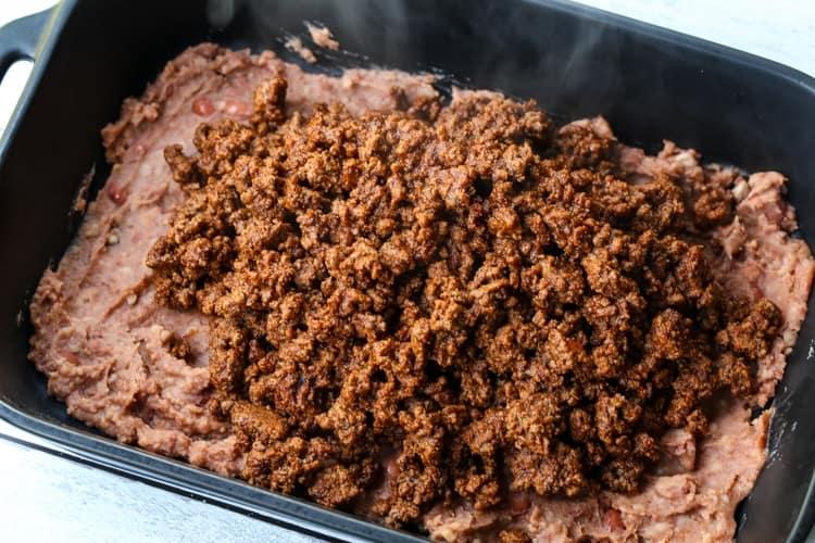 taco casserole in a black baking dish