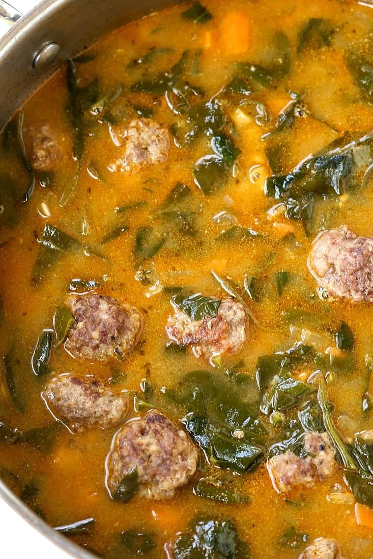 soup with meatballs and spinach in a pot
