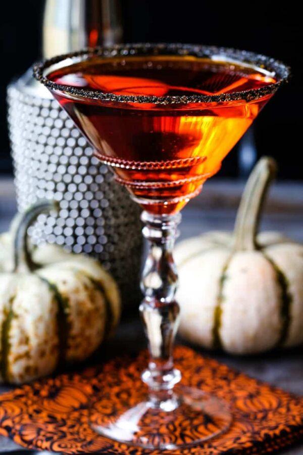 pumpkin drop martini in a sugar rimmed glass