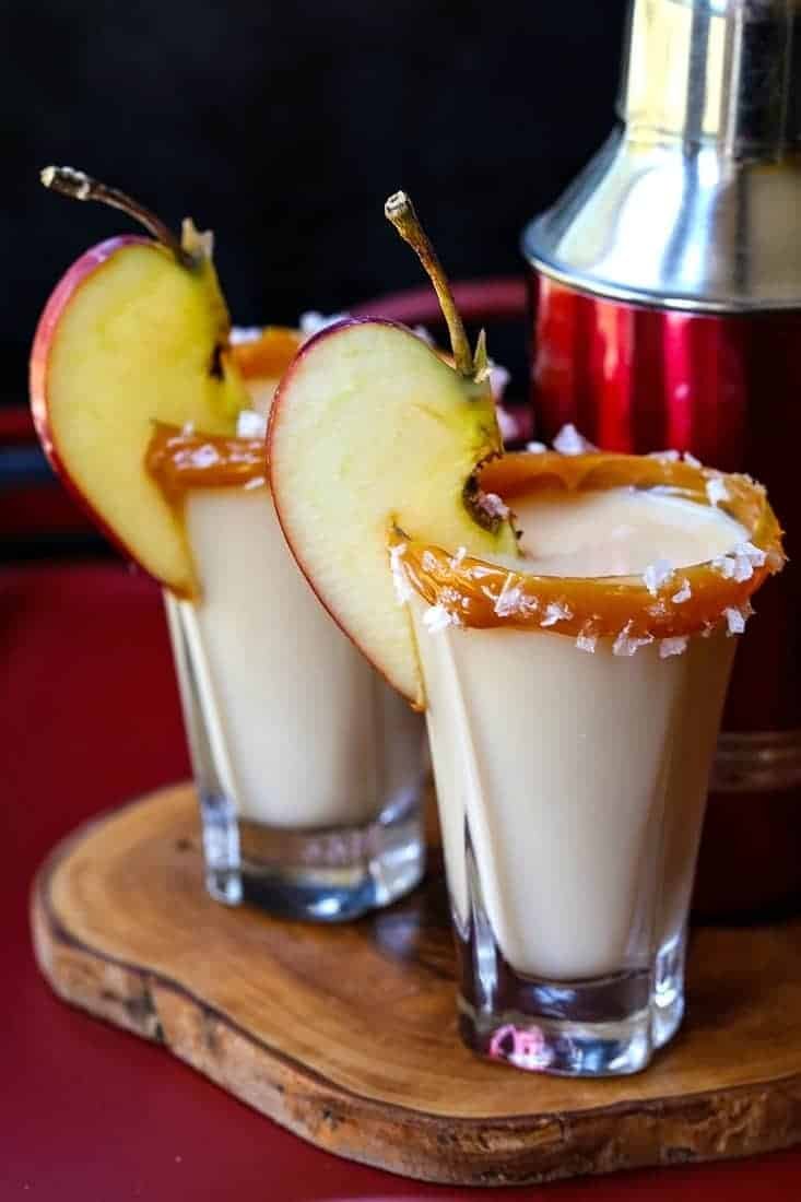 salted caramel apple shots with an apple slice for garnish